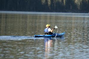 A morning Kayak'er cruising the lake