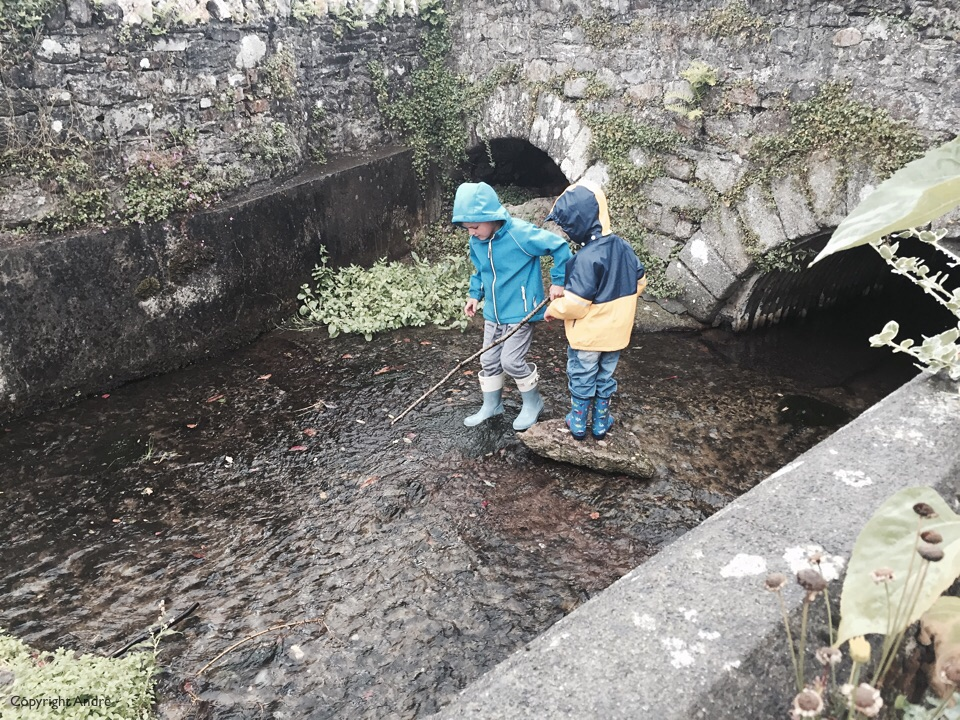 While waiting for the rain to clear up Max & Mathew played in the river.