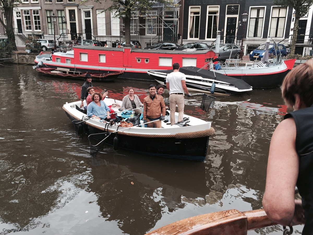 Picking up trash in the canals.