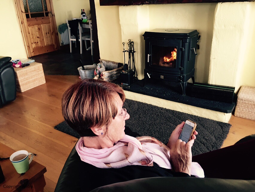 Nothing like your smart phone and a cozy fire.
