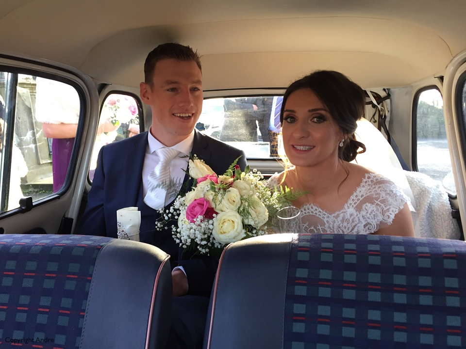 Bride & Groom off in the vintage car!